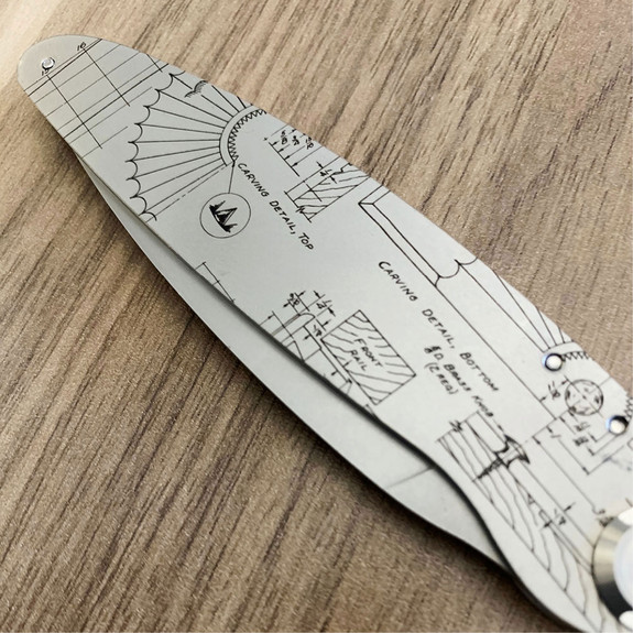 Folding Knife with engraved outdoor tool design closed