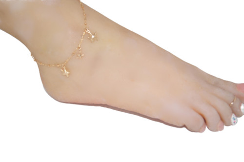 Gold anklet with star fish dangling charms