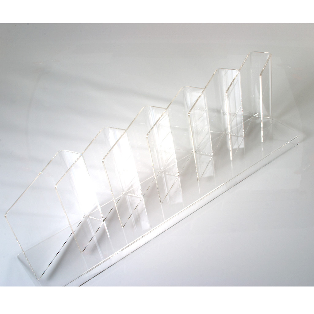 Shelf insert for books, calendars, and large format items for retail display.