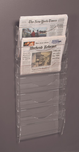 Clear acrylic wall mounted newspaper rack with six pockets.