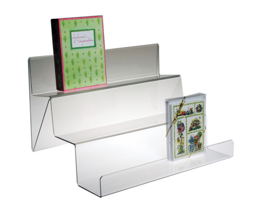 This clear acrylic three tiered shelf for the countertop has open sides and is braced from beneath for extra support.