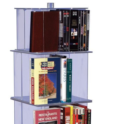Interchangeable clear acrylic spinner shelf units for retail display of books, journals, DVDs and accessories.