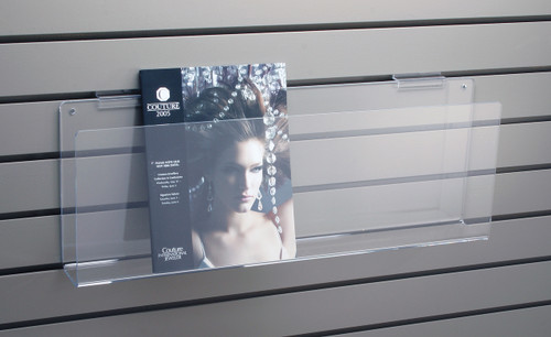 Clear acrylic magazine shelf for slatwall.