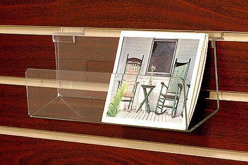 "Clear acrylic 14"" wide slatwall shelf with lip for boxed notecards, CDs, DVDs, books."