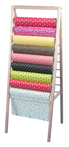 This simple and elegant wooden floor rack is a great solution for displaying wrapping paper, scarves and similar items to best advantage.