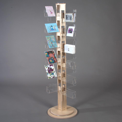 Wooden Floor spinner with clear acrylic pockets and birch wood core for post cards and greeting cards.
