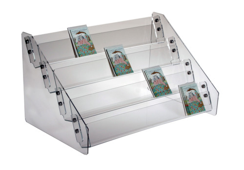 Clear acrylic countertop rack for small item retail display.