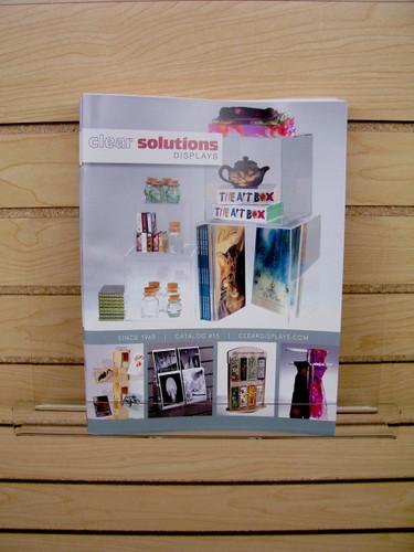 "Back Aisle Special - 13"" wide Slatwall Shelf stocked on slatwall with catalog"