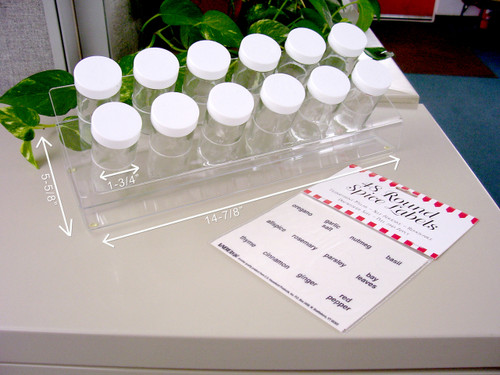 Clear acrylic spice rack with 12 glass jars and package of 48 spice labels.
