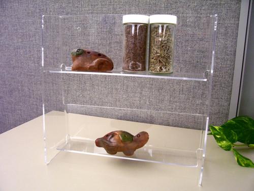 Clear acrylic two shelf display.