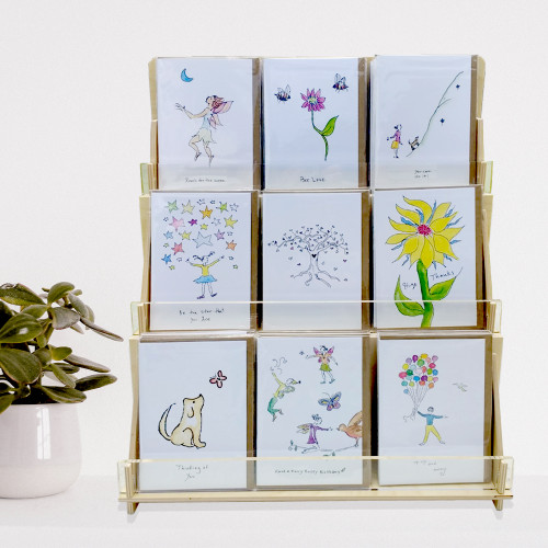 Retail display for A2 sized greeting cards (4.25 By 5.5 inches) for maximum visibility of all card fronts. With plant - Rosie's Wonders.