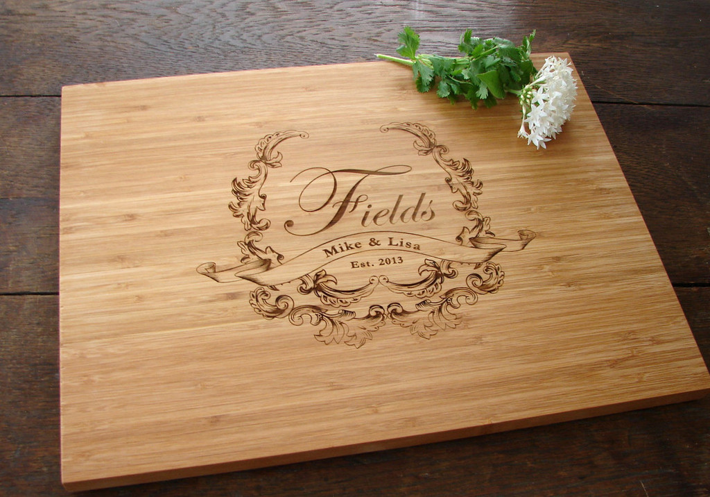 Personalized cutting board with crest design