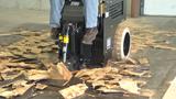 Scraper removing hardwood floor