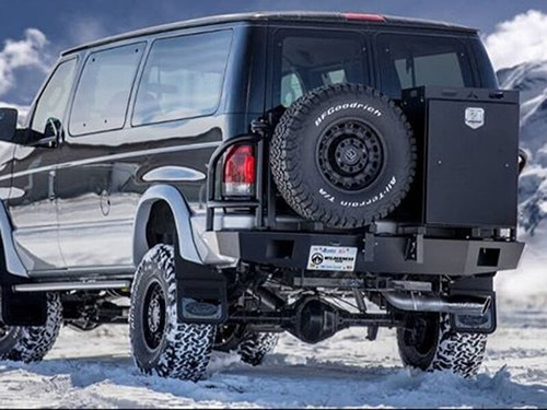 Aluminess rear bumper with tire rack and storage galley box a black lifted Ford E Series Van
