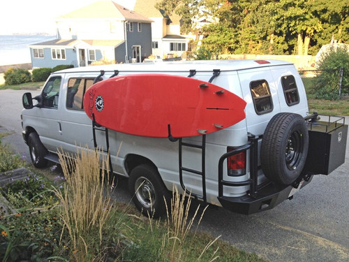 Surf hooks mounted on the side of a Chevy Express Van.