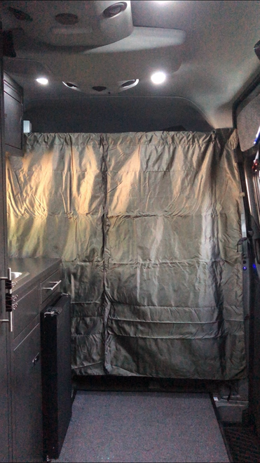 Stealth Blackout Curtain blocking off the driver's seat of this camper van