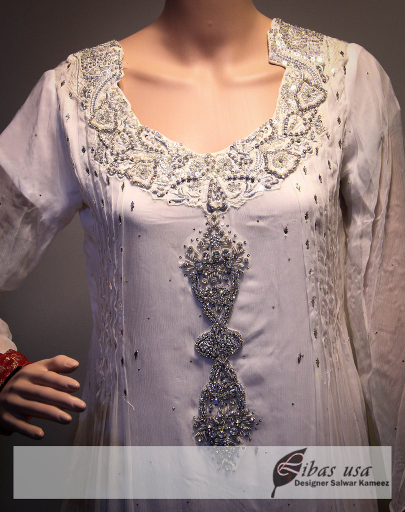 White embroidered dress with red trousers / Anarkali