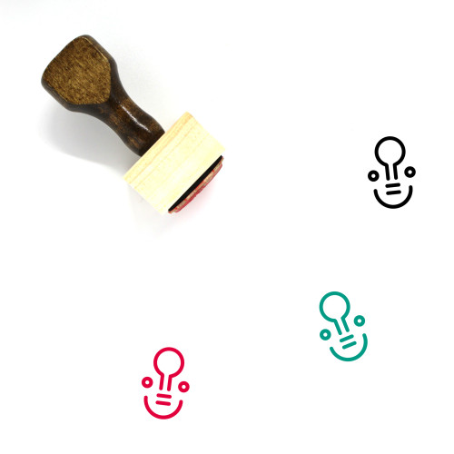 """Genius"" wooden rubber stamp with 3 sample imprints of the image"