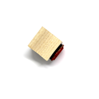 A wooden rubber stamp with not handle, wooden block only.