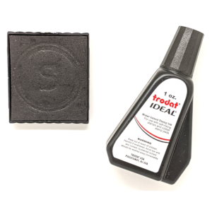 An ink pad for self-inking rubber stamps and ink vial