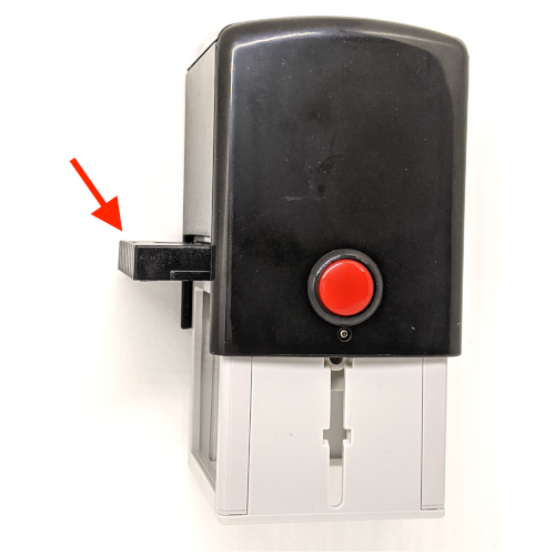 An arrow pointing to the ink pad built into the self-inking rubber stamp, showing how the ink pad slides out.