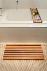 A Structurally Well Crafted Cedar Bath Mat And Bath Caddy
