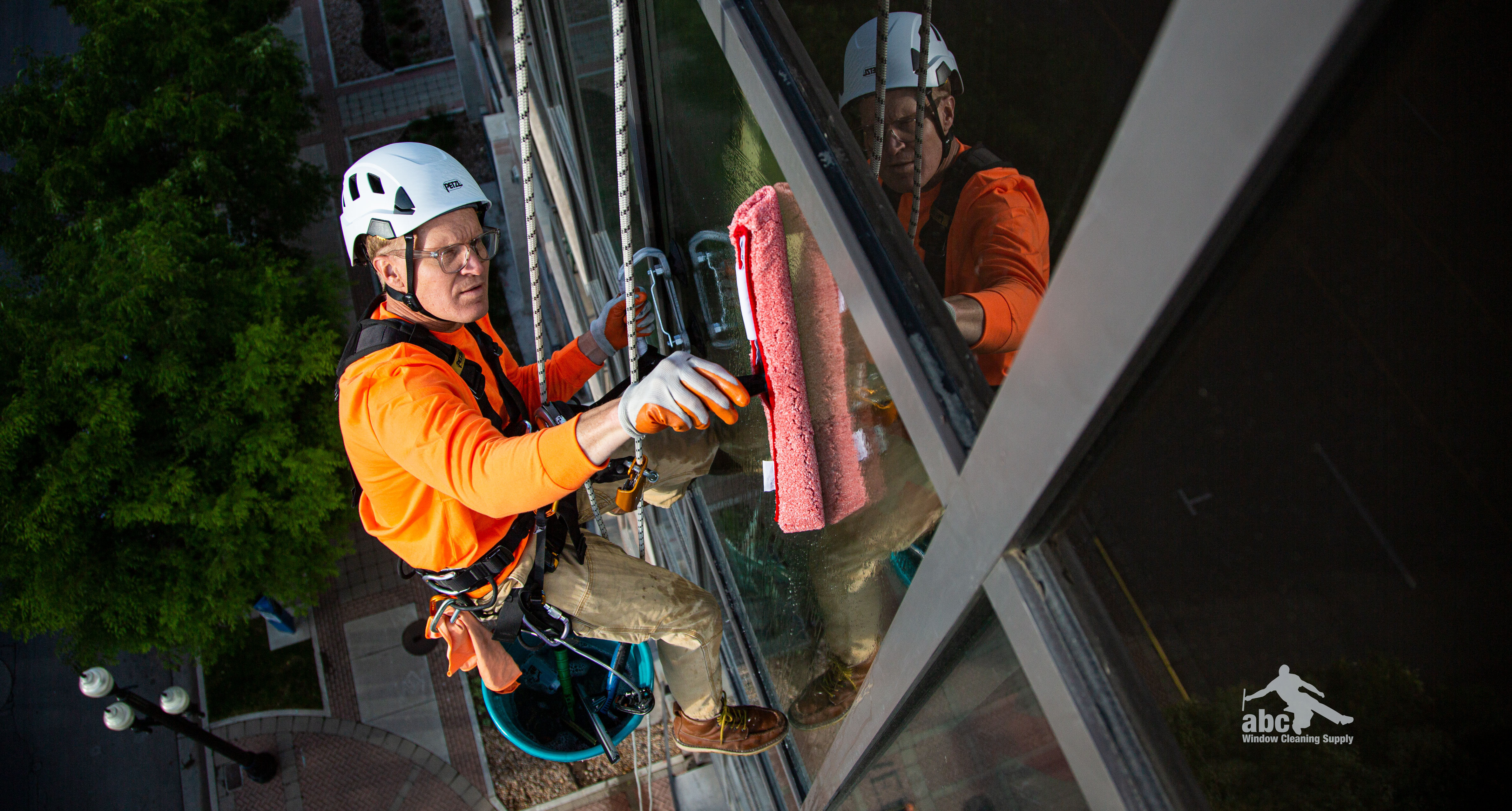 High rise window cleaning in action with a rope descent system.