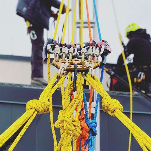 Various colors of rope in use for window cleaning rope access.