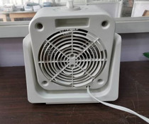 BACK VIEW OF WHITE FAN/HEATER
