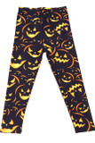 Flat front view of our Buttery Soft Evil Halloween Pumpkins Kids Leggings featuring lit up orange glowing jack-o-lantern faces contrasting a black background.
