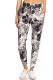 Front view image of our Buttery Soft Black and White Floral Joggers with pockets, fitted ankle cuffs, and an elastic tie string waist.