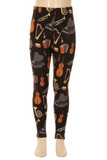 Front view image of our Buttery Soft Musical Instrument Kids Leggings with a neutral toned instrument print that features pianos, harps, violins, and more on a black fabric base.