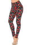 Left side right bent knee image of Buttery Soft Traditional Country Christmas Plus Size Leggings featuring a lovely holiday themed design consisting of a background the looks like falling snow against a black base decorated with poinsettias, candy canes, cinnamon sticks, red bows, and snowflakes.