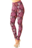 Left side view of our gorgeous burgundy toned Buttery Soft Festive Snowflake Ornaments Leggings with a beautiful intricate all over snowflake print.