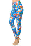 Partial angled front view image of Creamy Soft Gorgeous Blue Christmas Leggings featuring a vibrant holiday themed print consisting of Santa, snowman, presents, and more atop a bright blue background.