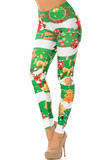 Left side vie of Holiday Festive Green Christmas Garland Wrap Leggings with a thick red and white horizontal striped background decorated with festive touched like wreaths, colorful string light, and Christmas cookies.