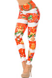Left side vie of Holiday Festive Red Christmas Garland Wrap Leggings with a thick red and white horizontal striped background decorated with festive touched like wreaths, colorful string light, and Christmas cookies.
