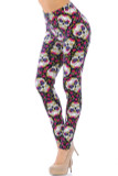 These edgy Day of the Dead themed Buttery Soft Floral Petal Sugar Skull Leggings are adorned with edgy sugar skulls, vibrant fuchsia flowers, yellow and purple petals, and filigree accents, contrasting a black background.