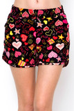 """Front view of our Buttery Soft Symbols of Love Dolphin Shorts adorned with red and pink hearts, flower and star accents, and the words """"love you"""" and """"kiss"""" on a black background."""