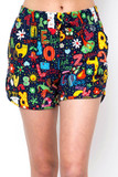 Front view of Buttery Soft Animal Letters Dolphin Shorts with a multicolored print that features animals and letters.