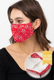 Left side view of Red Bandana Fashion Face Mask with Built In Filter and Nose Bar featuring a white paisley design.