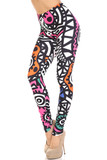 45 degree view of Creamy Soft Color Tribe Extra Plus Size Leggings - 3X-5X - By USA Fashion™ with a retro 90s style tribal design with black and white and pops of color.