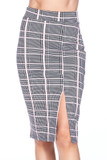 Front side of Baby Pink Glen Plaid Plus Size Midi Pencil Skirt with Front Slit showing off the split hem over the left leg
