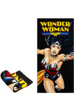 Flat and rolled up view of Wonder Woman Oversized Cotton Beach Towel with a laser printed Wonder Woman design on a black background.