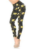 45 degree view of our amazing Buttery Soft Juicy Summer Lemons Leggings with an all over yellow on black lemon design.