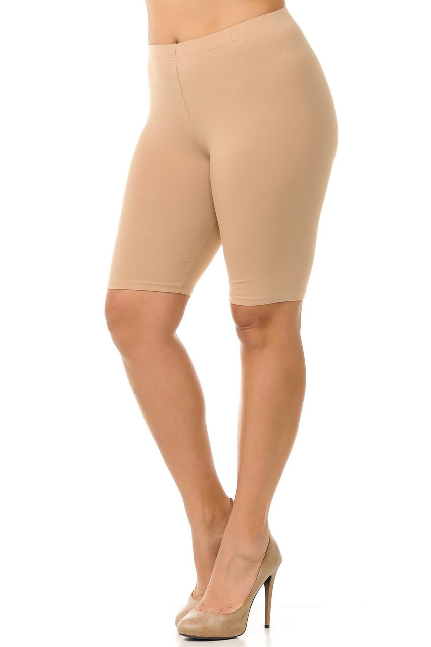 45 degree view of beige made in the USA Cotton Thigh Plus Size Shorts featuring a biker length cut.
