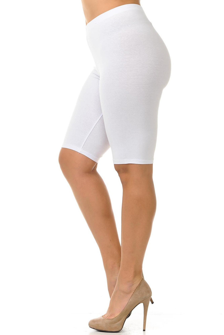 Left side view of a crisp white pair of Bermuda length USA cotton plus size shorts, hitting just above the knee.