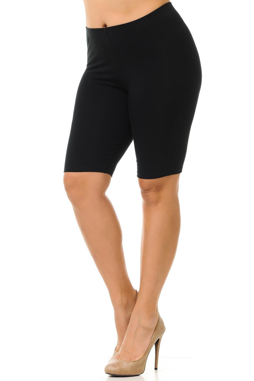 45 degree view of Black made in the USA Cotton Thigh Plus Size Shorts pictured styled with nude heels.