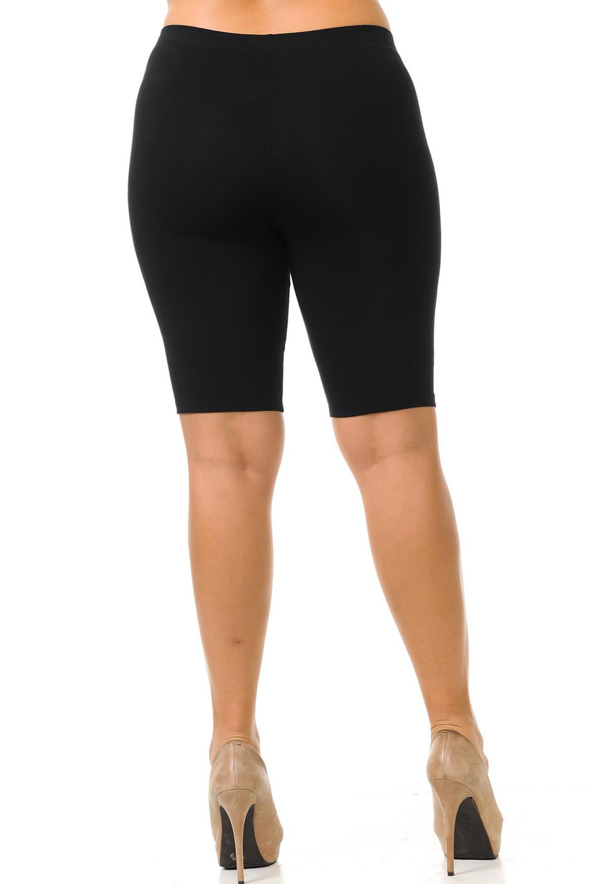 Rear view of  solid black cotton made in the USA thigh plus size shorts.