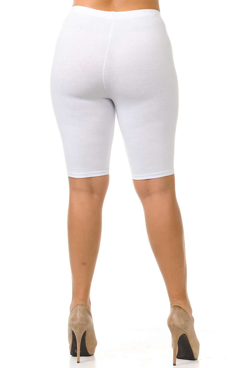 Rear view of figure forming white USA plus size shorts with a biker length hem.